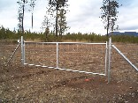 12 foot drive custom galvanized gate with field fence on it