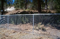5 foot galvanized chain link fence with 1 5/8 top rail and steel fittings at a pizza place in the Spokane Valley, Washington