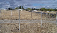 2 layers of 47 inch field fence with top rail, approximate height 6 ft.