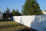 White PDS slats with 2 3/8 line posts to support the slats and fence during those windy days